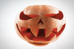 Very scary Halloween pumpkin on a white isolated background with. Out glow royalty free stock photography