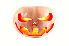 Very scary Halloween pumpkin on a white isolated background with. A glow inside stock photography