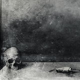 Very scary skull on table. Textured grunge black and white background Royalty Free Stock Images
