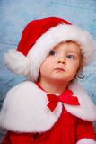 Very serious baby in santa hat Stock Images