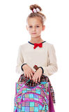 Very serious little schoolgirl with satchel in Royalty Free Stock Image