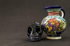 A very serious Talavera Puebla vase with a black Oaxaca skull. A very serious Talavera vase with a black Oaxaca skull,talavera colors stock photos