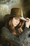 Very brawn hair cowgirl Stock Photography