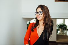 Very Sexy Business Woman Standing At White Wall In Her Office. Stock Photography