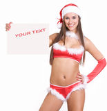 Very sexy christmas girl holding empty white board Royalty Free Stock Image