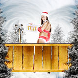 Very christmas girl holding empty white board Royalty Free Stock Image