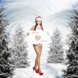 Very christmas girl holding empty white board Royalty Free Stock Photos