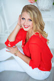 Very girl smiling with perfect make-up in the red shirt royalty free stock photo