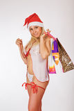 Very sexy Mrs. Santa Claus girl holding gifts. In underwear Stock Photos