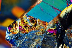 Very sharp Titanium rainbow aura quartz crystal Stock Photography