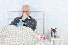 Very sick man laying in bed Stock Photos
