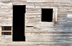 Simple door and window of old 1800s American settler home Royalty Free Stock Photos
