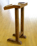 Very simple wooden cathedra tribune for lecture Stock Photos