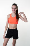 A very skinny woman wearing sport wear with long hair Stock Photography