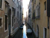 Very slim canal in Venezia. Very slim canal between houses in Venezia stock photography