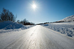 Slippery winter road. Very slippery road with plow edges alongside Royalty Free Stock Images