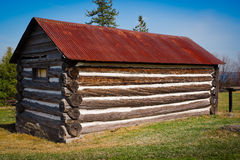 Very Small, Old Log Cabin with Rusted Tin Roof Stock Photography
