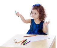 Very smart little girl draws with pencils sitting Royalty Free Stock Photo