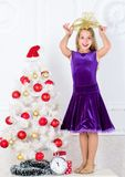 Very special time of year. Kid happy because holiday season arrive. Family holiday concept. Girl velvet dress feel. Festive near christmas tree. Make this day stock images