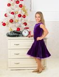 Very special time of year. Kid happy because holiday season arrive. Winter holiday concept. Family holiday concept. Girl. Velvet dress feel festive near royalty free stock photography