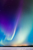Auroras over the lake Royalty Free Stock Images