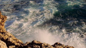 Very strong waves hitting against rocks wild water great shot stock video