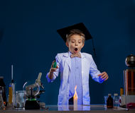 Very surprised boy conducting experiment in lab Royalty Free Stock Image