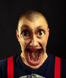 Very surprised screaming man Stock Images