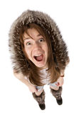 Very surprised woman in fur hat Royalty Free Stock Photography