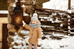Very sweet beautiful little girl child in a beige coat smiling a royalty free stock images