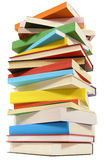 Very tall pile of books  on white background, low angle view Royalty Free Stock Photos