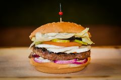 Very tasty burger with a juicy meatball. In cafe stock image