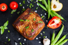 Very tasty cooked beef with spices and vegetables on old table royalty free stock photo