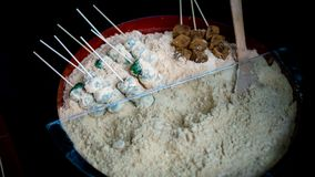 Very tasty Kibi or Kinako dango on the skewers and covered in slightly sweetened millet flour. Dango is a Japanese sweet dumpling made from rice flour similar Stock Images