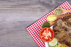 Very tasty meal on a plate. Pork grilled with fresh tomatoes and Royalty Free Stock Photography