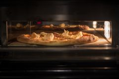 Very tasty pizza in a cafe Royalty Free Stock Photography
