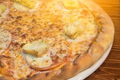 Very tasty pizza in a cafe Royalty Free Stock Images