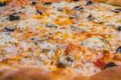 Very tasty pizza in a cafe Royalty Free Stock Photos