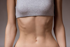 Very thin girl. Anorexia. Girl shows thin stomach and ribs close-up Stock Image