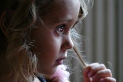 Thoughtful close up of a three year old girl. Very thoughtful close up of a three year old girl royalty free stock photography