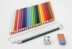 Very tidy basic school supplies. On a white background royalty free stock photo