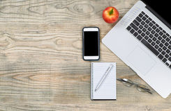 Very tidy workspace with red apple for snack Stock Images