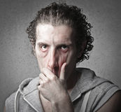Very Tired. Man pulling his face down Stock Photo