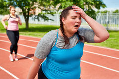 Very tired. Exhausted runner touching her head with funny facial expression Stock Images