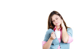 Very tired, almost falling asleep young woman, student holding a cup of coffee Stock Images