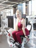 Very tired female in activewear sitting on bench royalty free stock images