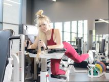 Very tired female in activewear sitting on bench royalty free stock photo