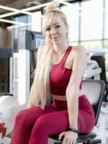 Very tired female in activewear sitting on bench stock photos