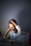 Very tired young woman, burning the midnigh oil Royalty Free Stock Images