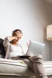 Very tired young woman, burning the midnigh oil Stock Photo